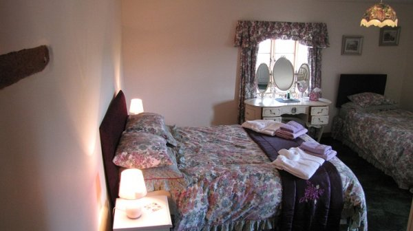 Higher Shippen, third bedroom downstairs with two steps down into room, containing 1 double bed and 1 single bed